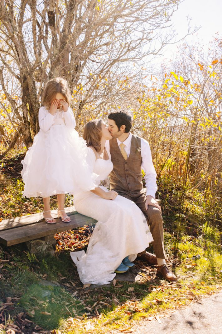 Flower Girl Hiding Her Eyes from Parents Kissing
