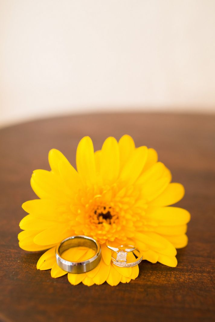 Wedding Ring Photographed on a Bright Yellow Flower